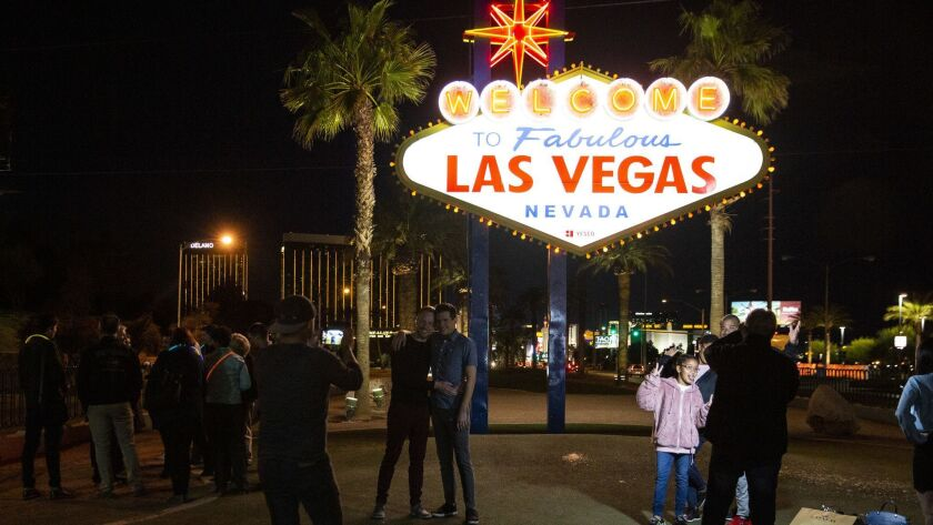 LAS VEGAS, NEV. - MARCH 21: People pose for pictures at the The Las Vegas sign on Thursday, March 21