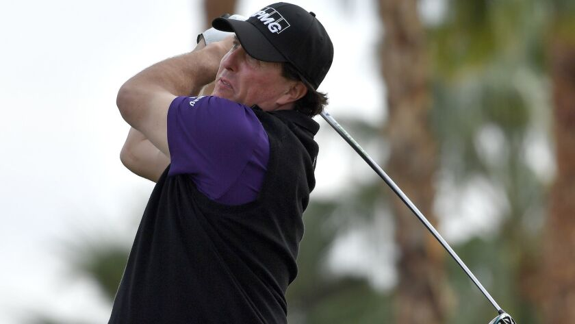 Phil Mickelson tees off at the fourth hole during the second round of the Desert Classic at the Nicklaus Tournament Course in La Quinta.