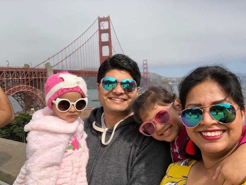 Poorva Dixit and her family pose for a photo in San Francisco, where she and her husband worked prior to being separated.