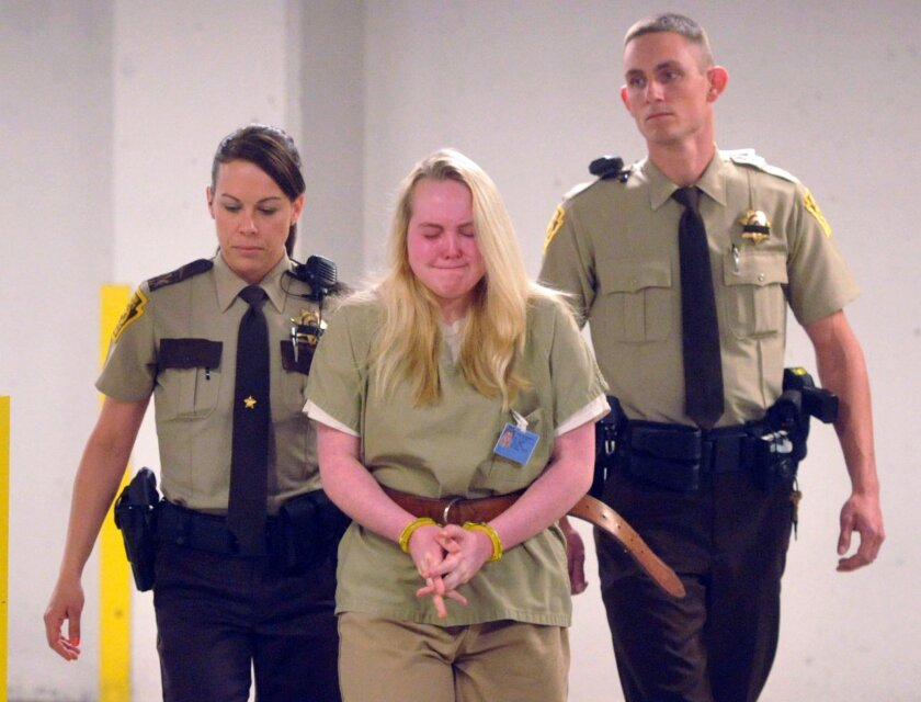 """FILE - In this May 14, 2015 file photo, Jamie Silvonek, 14, is escorted to court for a preliminary hearing in Allentown, Pa. On Thursday, Feb. 11, 2016, the teenager, accused of plotting with her boyfriend, Army Spc. Caleb Barnes, to kill her mother called herself """"a monster"""" as she pleaded guilty"""