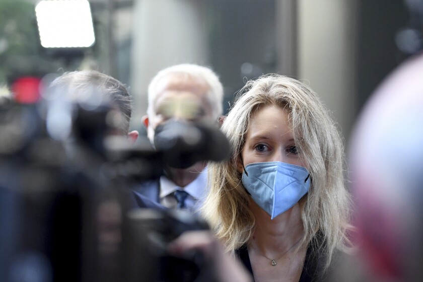 FILE - In this Tuesday, Aug. 31, 2021, file photo, Elizabeth Holmes, founder and CEO of Theranos, arrives at the federal courthouse for jury selection in her trial, in San Jose, Calif. Holmes convinced media mogul Rupert Murdoch and other billionaires to invest in her biotechnology startup despite warnings its unconventional blood tests were dangerously unreliable, according to evidence presented Tuesday, Sept. 28, 2021, during her criminal trial. (AP Photo/Nic Coury, File)