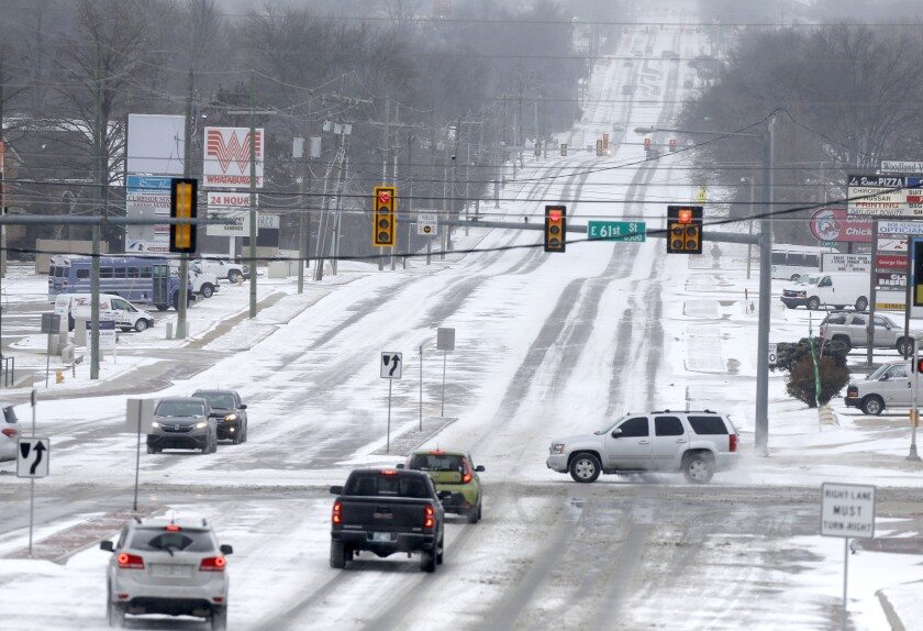 Snow covered city streets including at 61st and Sheridan in Tulsa as a winter storm moves in to northeast Oklahoma on Sunday, Feb. 14, 2021. (John Clanton/Tulsa World via AP)
