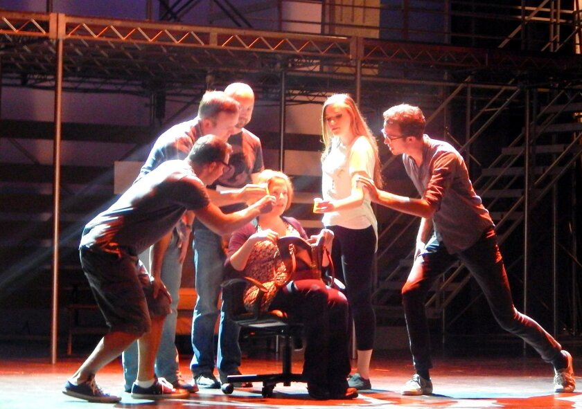 """Bets Malone (centers) stars in """"Next to Normal"""" at San Diego Musical Theatre."""