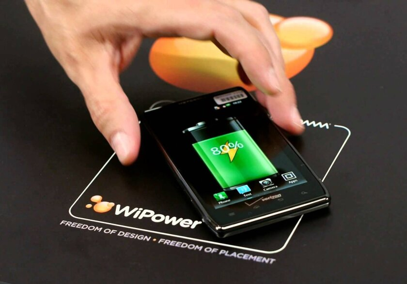 Qualcomm's WiPower system can wirelessly charge electronic devices with metal exteriors.