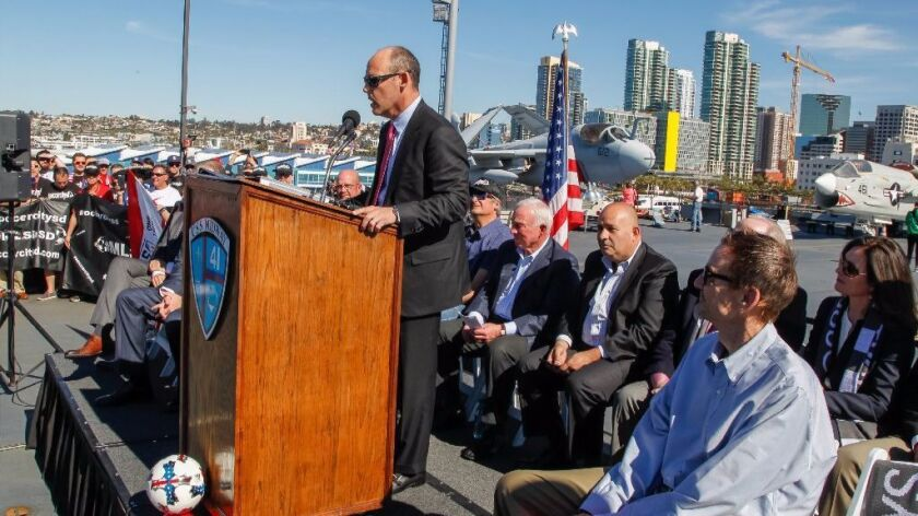 Investor Mike Stone speaks during a Major League Soccer press conference on the USS Midway Museum. The event was to announce that investors were submitting an application to bring an MLS team to San Diego and build a stadium in Mission Valley.