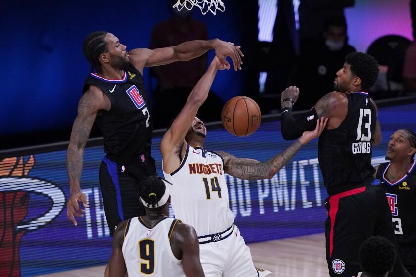 Denver Nuggets guard Gary Harris is blocked by Clippers forward Kawhi Leonard.