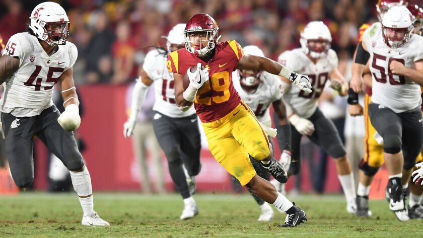 USC running back Vavae Malepeai picks up big yards against Washington State in the fourth quarter at the Coliseum on Friday.