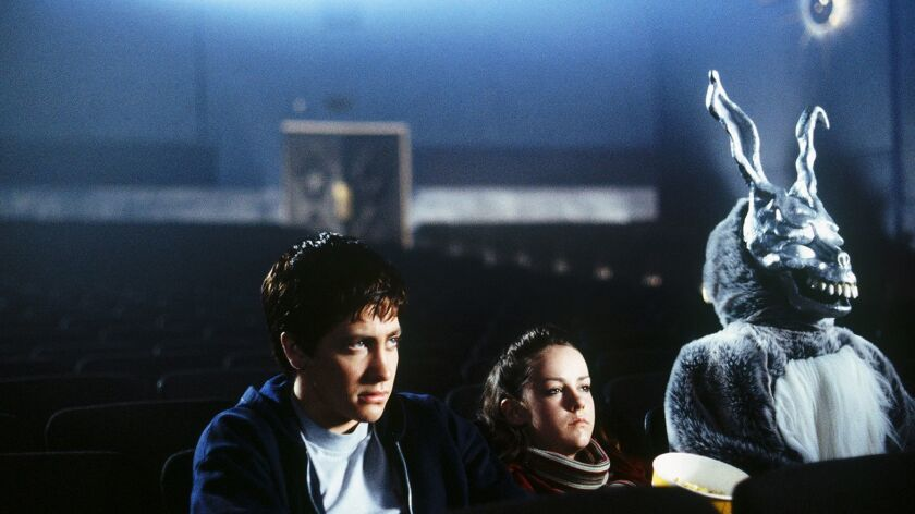 Jake Gyllenhaal as Donnie Darko, Jena Malone as Gretchen Ross and James Duval as Frank in the 2001 f