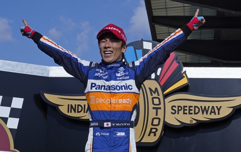 Takuma Sato celebrates after winning the Indianapolis 500 on Sunday for the second time.