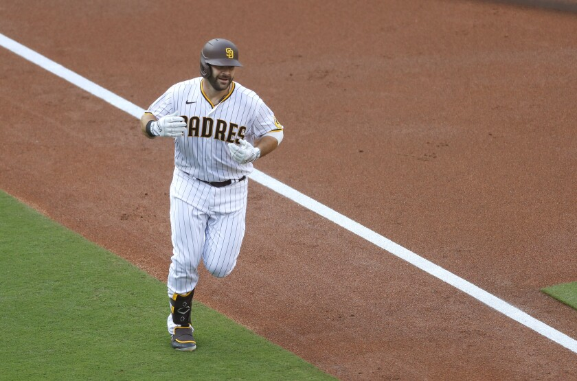 San Diego Padres Mitch Moreland rounds third base after hitting a two-run home run\