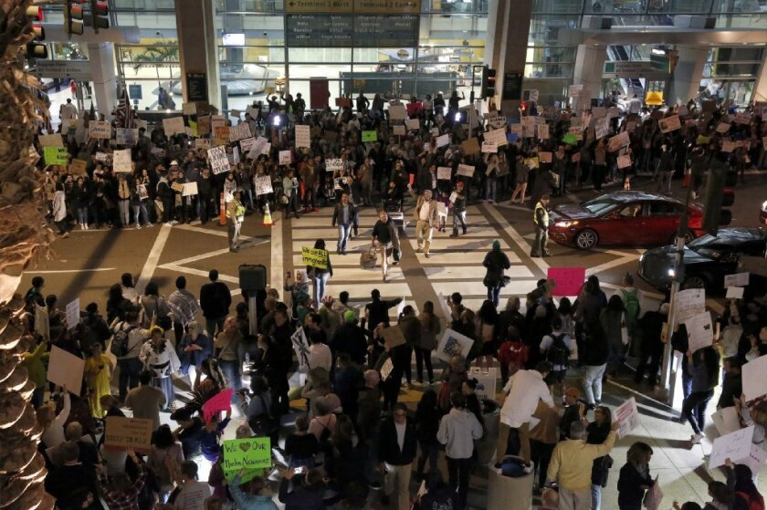 More than 1,000 San Diegans protest at Lindbergh Field after President Donald Trump's recent travel ban. This is the second night of the protest.