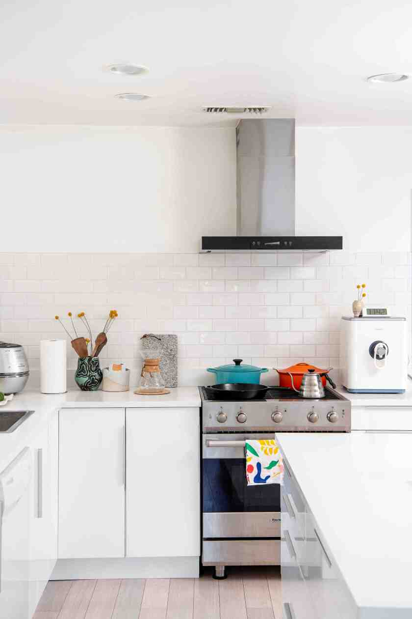 Ted Vadakan and Angie Myung's kitchen in Mt. Washington features inexpensive Ikea cabinets.