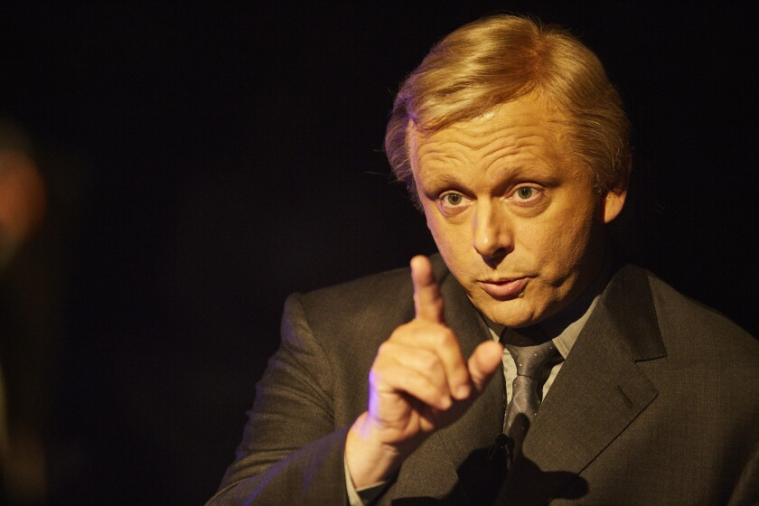 """Michael Sheen as """"Who Wants to Be a Millionaire?"""" host Chris Tarrant in """"Quiz."""""""