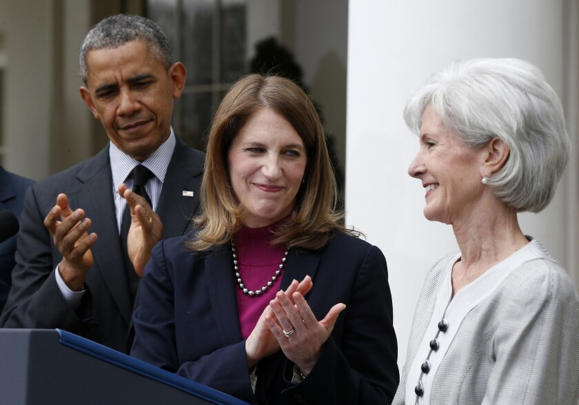 Soon to be her problem: HHS Secretary-designate Sylvia Mathews Burwell, center, flanked by President Obama and outgoing HHs Secretary Kathleen Sebelius.