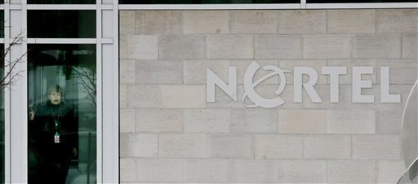 A woman looks out the window at  Nortel Networks' corporate headquarters in Toronto, Canada, Wednesday, Jan. 14, 2009. Shares in telecom equipment giant Nortel Networks Corp. lost nearly two thirds of their value Wednesday after the company and several of its units filed for bankruptcy protection f