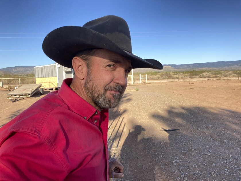Otero County Commissioner Couy Griffin, the founder of Cowboys for Trump, takes in the view from his ranch in Tularosa, N.M., on Wednesday, May 12, 2021. Griffin is reviled and revered in politically conservative Otero County as he confronts criminal charges for joining protests on an outdoor terrace of the U.S. Capitol on Jan. 6. He's also fighting for his political future amid a recall initiative and state probes into his finances. (AP Photo/Morgan Lee)