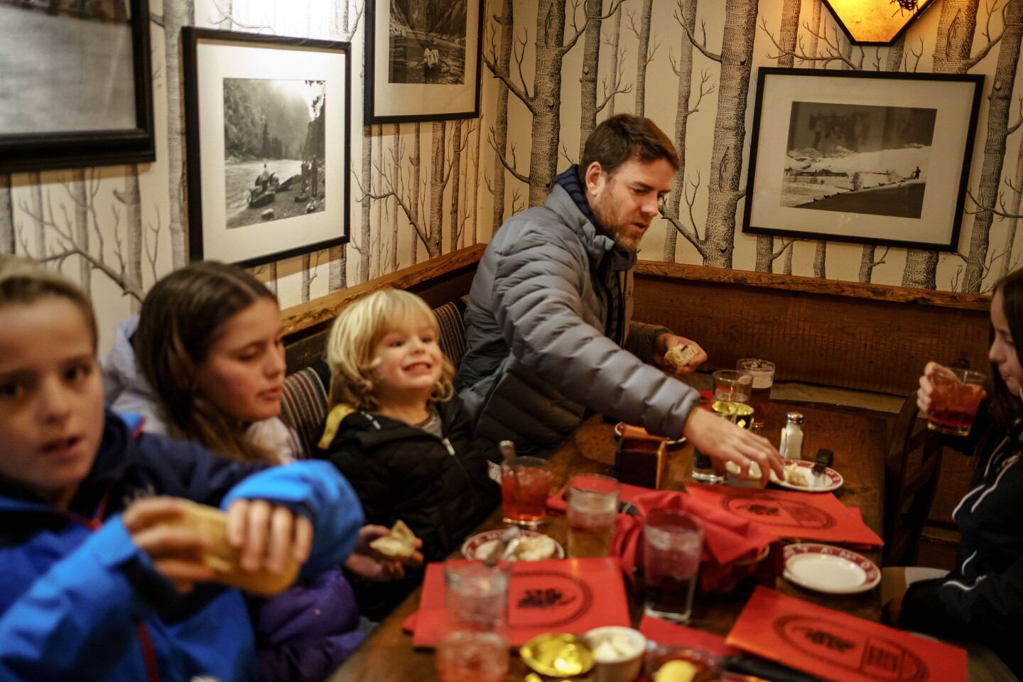 Carson Palmer takes his children, from left, Fletch, Bries, Carter and Elle out to dinner in Ketchum, Idaho, on Dec. 10.