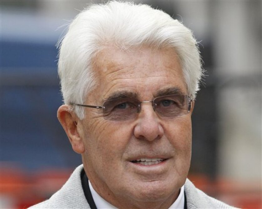 FILE - This is a Thursday, Feb. 9, 2012 file photo of celebrity publicist Max Clifford, as he arrives to testify at the final day of the first phase of the Leveson Inquiry, in central London. British prosecutors say they are charging prominent celebrity publicist Max Clifford with 11 counts of inde
