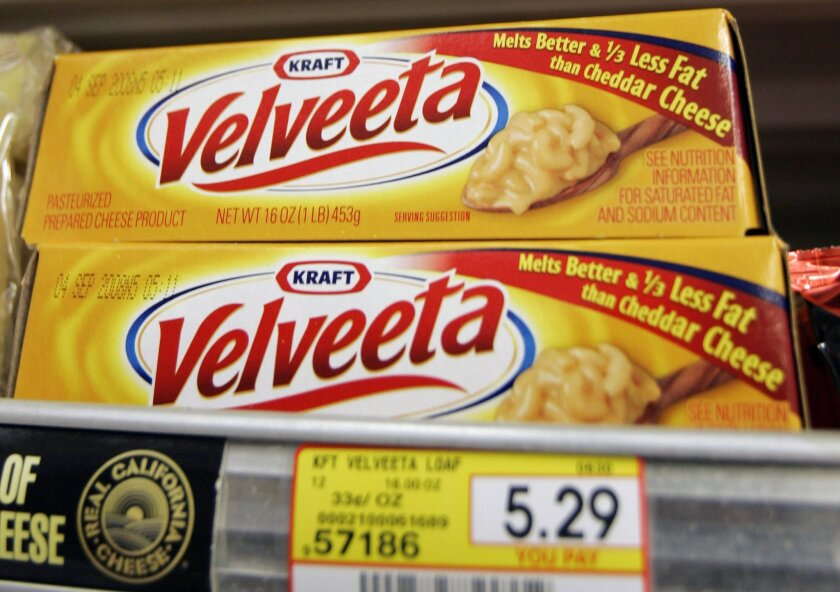 FILE- In this Monday, July 28, 2008, file photo, Kraft Foods' Velveeta cheese is displayed at J. J. & F. Market in Palo Alto, Calif.. Kraft Foods says Tuesday, Jan. 7, 2014, some customers may not be able to find Velveeta products over the next few weeks but didn't give any reasons for the apparent shortage. (AP Photo/Paul Sakuma, File)