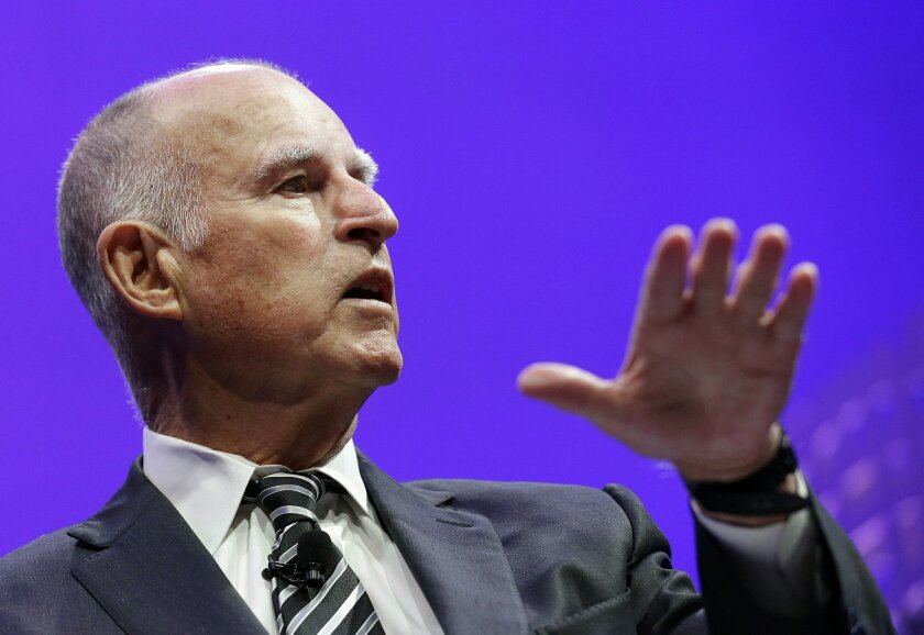 FILE - In this Nov. 2, 2015, file photo, Gov. Jerry Brown speaks on a panel at the Fortune Global Forum in San Francisco. A worker in the state oil and gas regulatory agency lodged a whistleblower's complaint over being ordered to prepare a state map of the oil and gas potential, history and geolog
