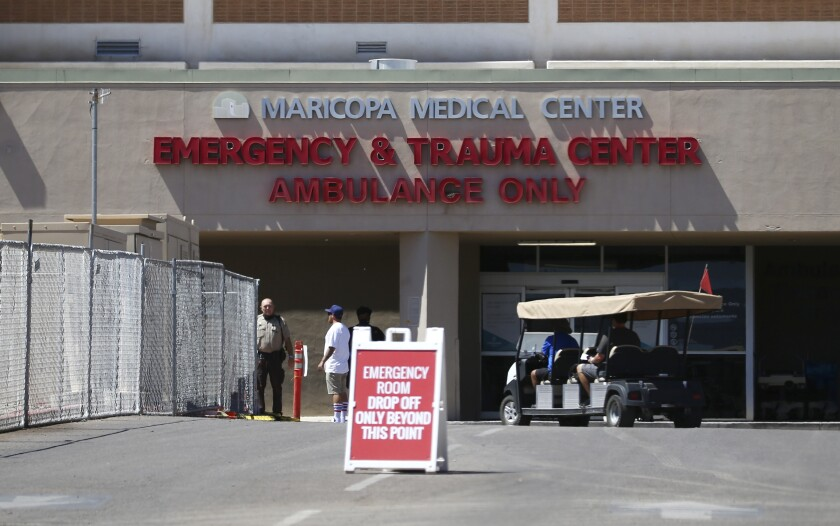 The emergency room entrance at Valleywise Health Center hospital is shown Wednesday, June 10, 2020, in Phoenix, as Arizona hospitals that are expected to be able to treat new cases of coronavirus without going into crisis mode were above 80% capacity Tuesday, a milestone that should trigger an automatic stop to elective surgeries at affected hospitals. The state is dealing with a surge in virus cases and hospitalizations that experts say is likely tied to Gov. Doug Ducey's ending of statewide closure orders in mid-May. (AP Photo/Ross D. Franklin)