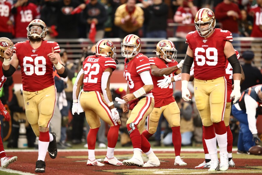 Jimmy Garoppolo (10) and the Super Bowl-bound San Francisco 49ers celebrate after a touchdown against the Green Bay Packers on Jan. 19 at Levi's Stadium.