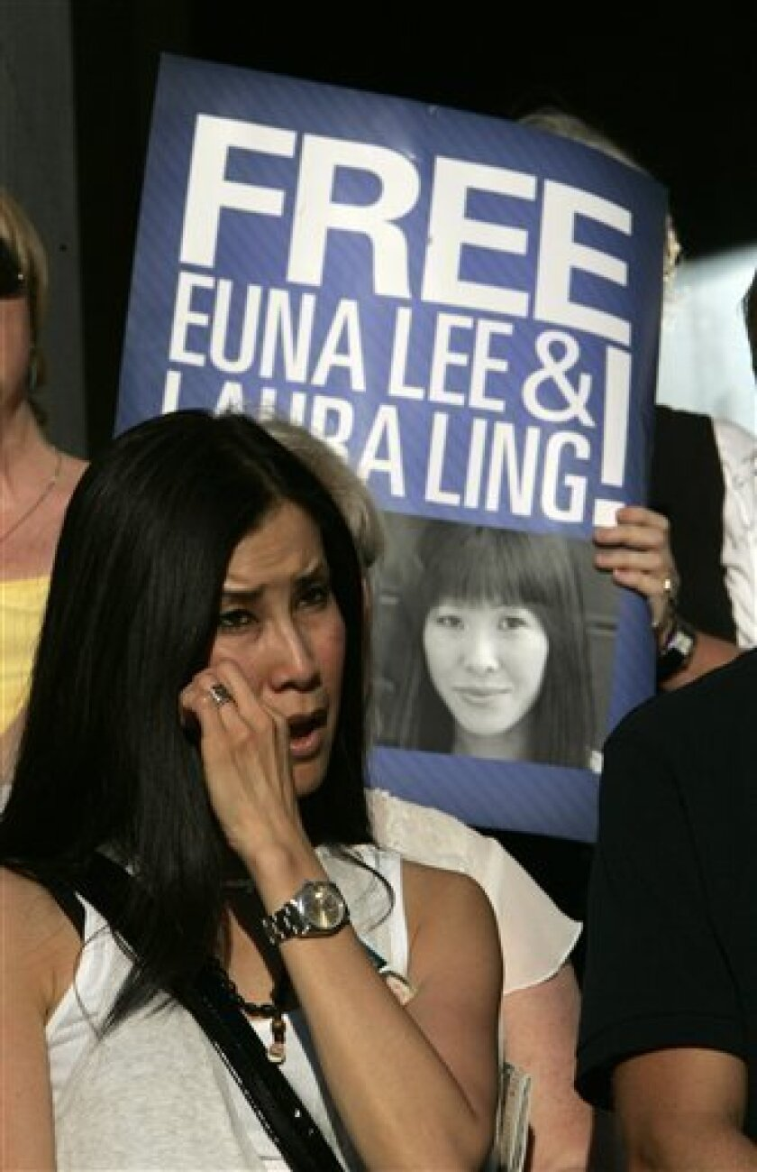 "Lisa Ling, the sister of imprisoned journalist Laura Ling, wipes her eye during a rally at the Capitol in Sacramento, Calif., Thursday, July 9, 2009. More than 250 people gathered at a vigil in support of Laura Ling and fellow journalist Euna Lee who were sentenced to 12 years of hard labor by North Korea for entering the country illegally and ""hostile acts."" (AP Photo/Rich Pedroncelli)"