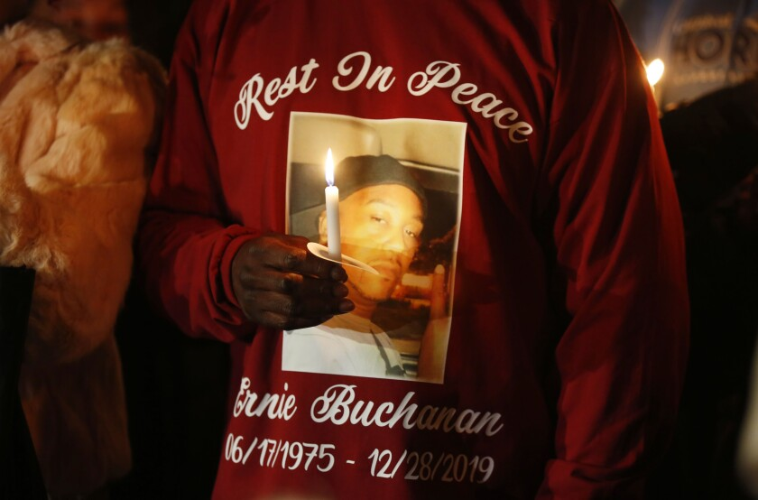 Mourners held a candlelight vigil Dec. 30 for Ernie Buchanan outside the homeless shelter in the East Village where he was gunned down Dec. 28.
