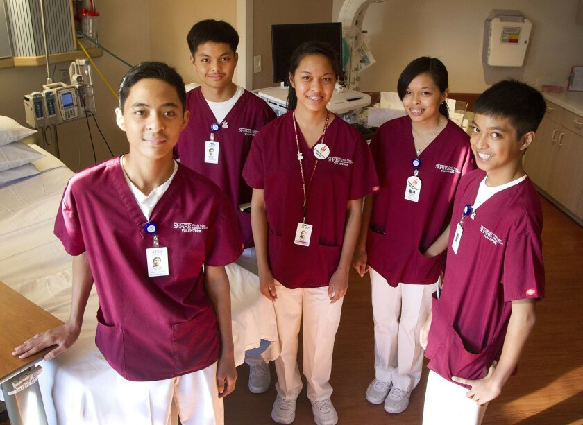 Left to right, Garner Rey, Gerard Rey, Adele Ray, Audrey Rey, and Gilbert Rey are all volunteers at Sharp Chula Vista.