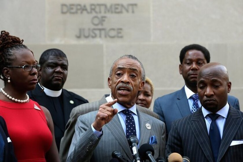 Rev. Al Sharpton speaks during a news conference outside the Department of Justice while discussing Trayvon Martin case. Sharpton called for the federal government to investigate civil rights charges against George Zimmerman.