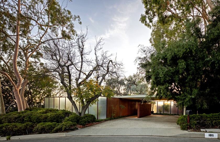 The home's simple wall of translucent panels shields bedrooms — a light-infused modernist ornament amid Bel-Air's mash of mansions and pillared gates.