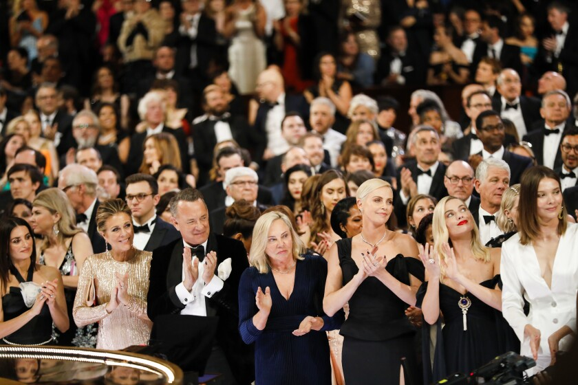 "Rita Wilson, Tom Hanks and Charlize Theron react as Renée Zellweger wins the lead actress Oscar for ""Judy"" in February."