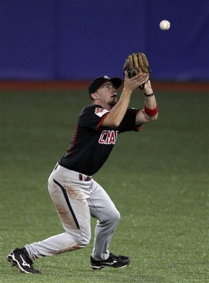 Canada second baseman Skyler Stromsmoe catches a fly during the second inning of the final baseball game against the United States at the Pan American Games in Lagos de Moreno, Mexico, Tuesday Oct. 25, 2011. (AP Photo/Javier Galeano)