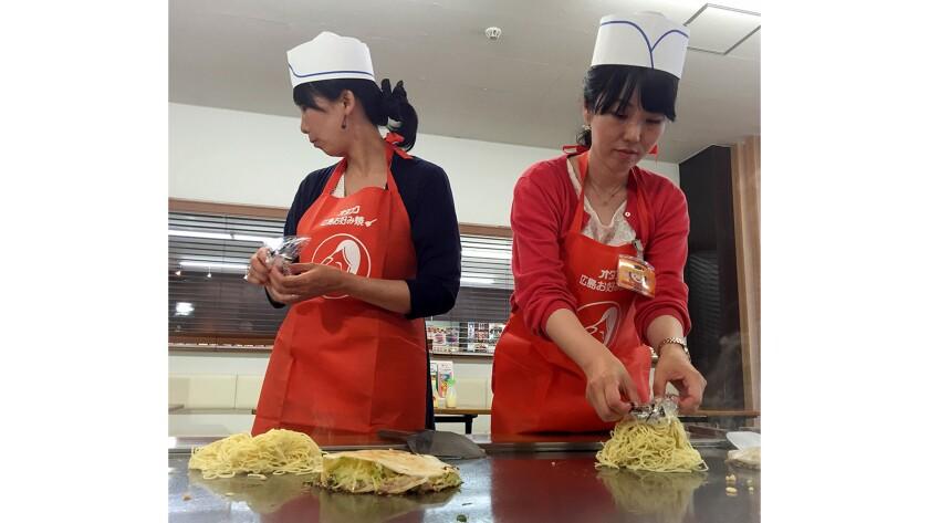 Students learn how to make okonomiyaki at the Otafuku Sauce Co.'s museum and cooking studio in Hiroshima.