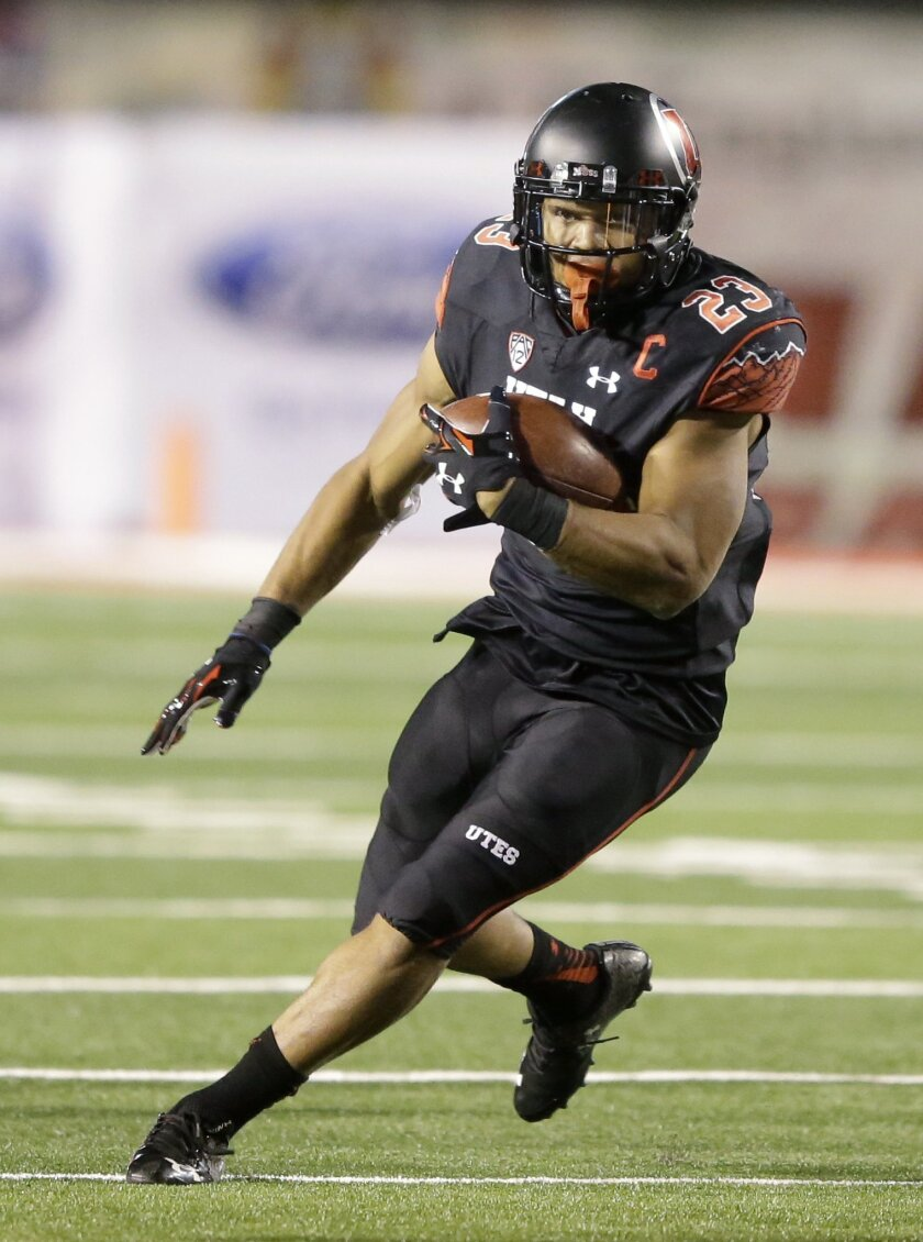 File - This Saturday, Oct. 31, 2015, file photo, shows Utah running back Devontae Booker (23) carrying the ball in the second half during an NCAA college football game against Oregon State, in Salt Lake City. Running backs Leonard Fournette and Dalvin Cook are regularly mentioned Heisman conversati
