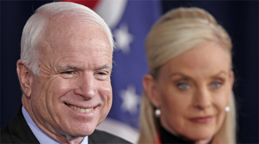 Presidential hopeful, Sen. John McCain, left, speaks at a news conference in Columbus, Ohio with his wife, Cindy.