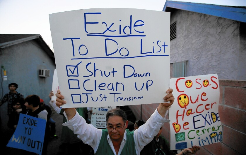 Community members and activists gather in a backyard of a home east of downtown Los Angeles to celebrate the closure of the Exide Technologies battery recycling plant on March 12.