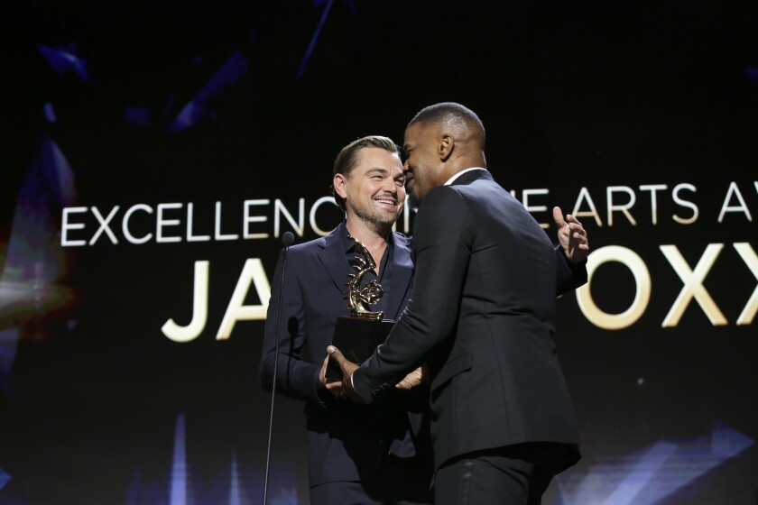 Leonardo DiCaprio and Jamie Foxx at 2020 American Black Film Festival Honors