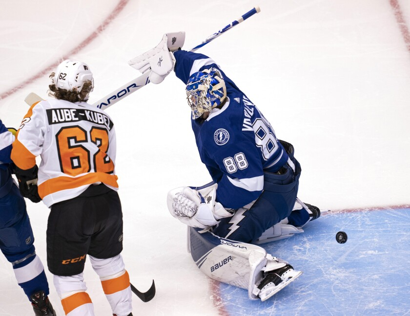 Philadelphia Flyers right wing Nicolas Aube-Kubel (62) scores on Tampa Bay Lightning goaltender Andrei Vasilevskiy (88) during the first period of an NHL hockey playoff game Saturday, Aug. 8, 2020, in Toronto. (Frank Gunn/The Canadian Press via AP)