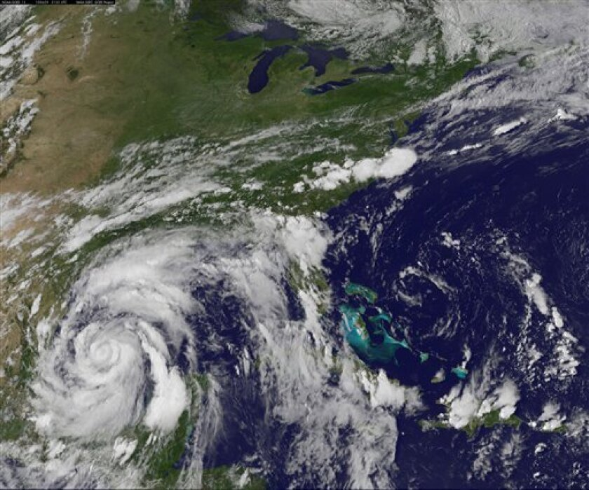 This image provided by NOAA was acquired Tuesday June 29, 2010 at 5:32 p.m. EDT shows Hurricane Alex churning through the western Gulf, taking aim at the Mexico-Texas border and far away from the massive oil spill. At 11 p.m. EDT Alex was located 255 miles (415 km) sooutheast of Brownsville, Texas moving west at 9 mph with maximum sustained winds of 75 mph. Hurricane-force winds extended up to 15 miles (30 kilometers) from the storm's center. (AP Photo/NOAA)