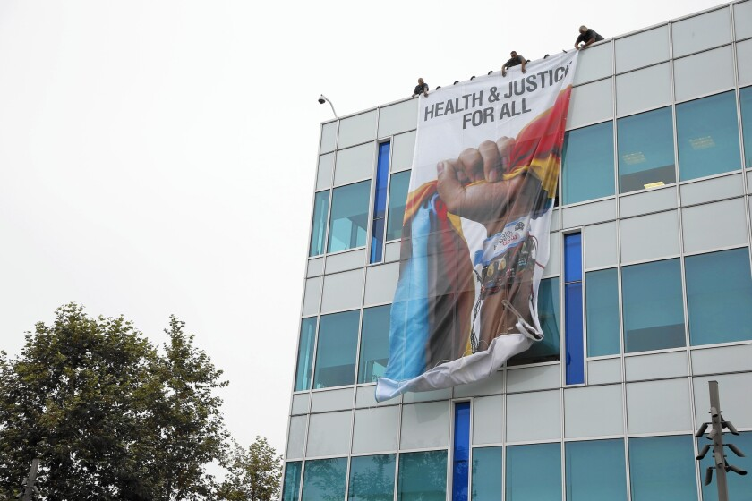 A 700-square-foot banner on the side of the California Endowment's building celebrates the budget signed by Gov. Jerry Brown, which includes healthcare for children in the country illegally.