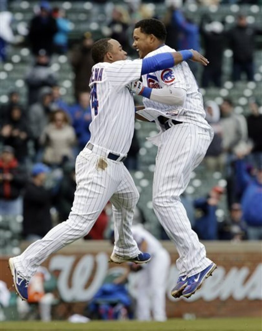 Chicago Cubs' Starlin Castro, right, celebrates with teammate Luis Valbuena after hitting a game-winning double against the San Francisco Giants during the ninth inning of a baseball game in Chicago, Friday, April 12, 2013. The Cubs won 4-3. (AP Photo/Nam Y. Huh)