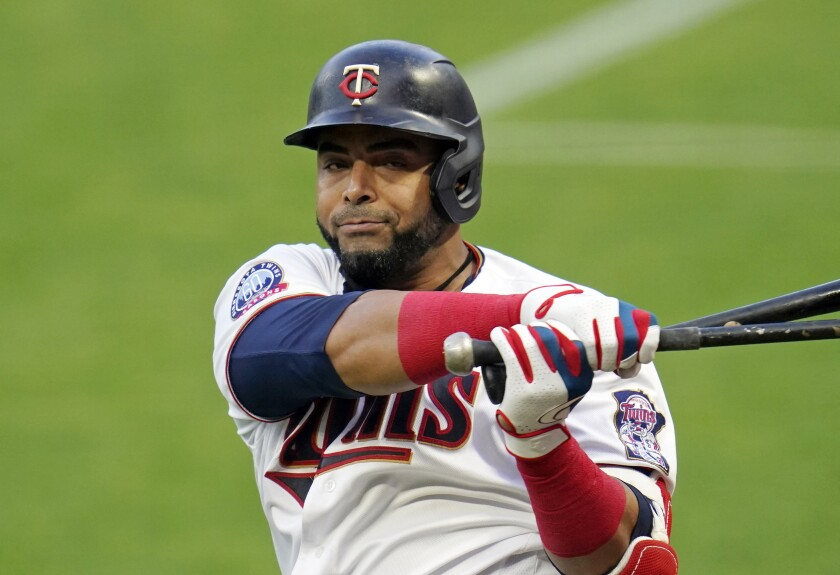 FILE - In this Monday, Aug. 31 2020 file photo, Minnesota Twins designated hitter Nelson Cruz (23)} waits to bat against the Chicago White Sox in a baseball game in Minneapolis. Minnesota Twins manager Rocco Baldelli has made no secret of the team's desire to re-sign designated hitter Nelson Cruz. Baldelli took his interest in the 40-year-old free agent a step further by taking a few seconds out of his video conference call with reporters to make a pretend pitch to the six-time All-Star. Cruz has batted .308 with 57 home runs, 141 RBIs and a 1.020 on-base-plus-slugging percentage in 173 games with the Twins. He's been their best hitter over Baldelli's two seasons and a significant reason why they've won the AL Central both years. (AP Photo/Jim Mone, File)