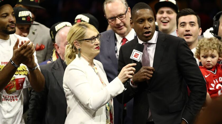 Toronto Raptors president Masai Ujiri is interviewed after his team's victory over the Golden State Warriors to clinch the NBA title Thursday at Oracle Arena in Oakland.
