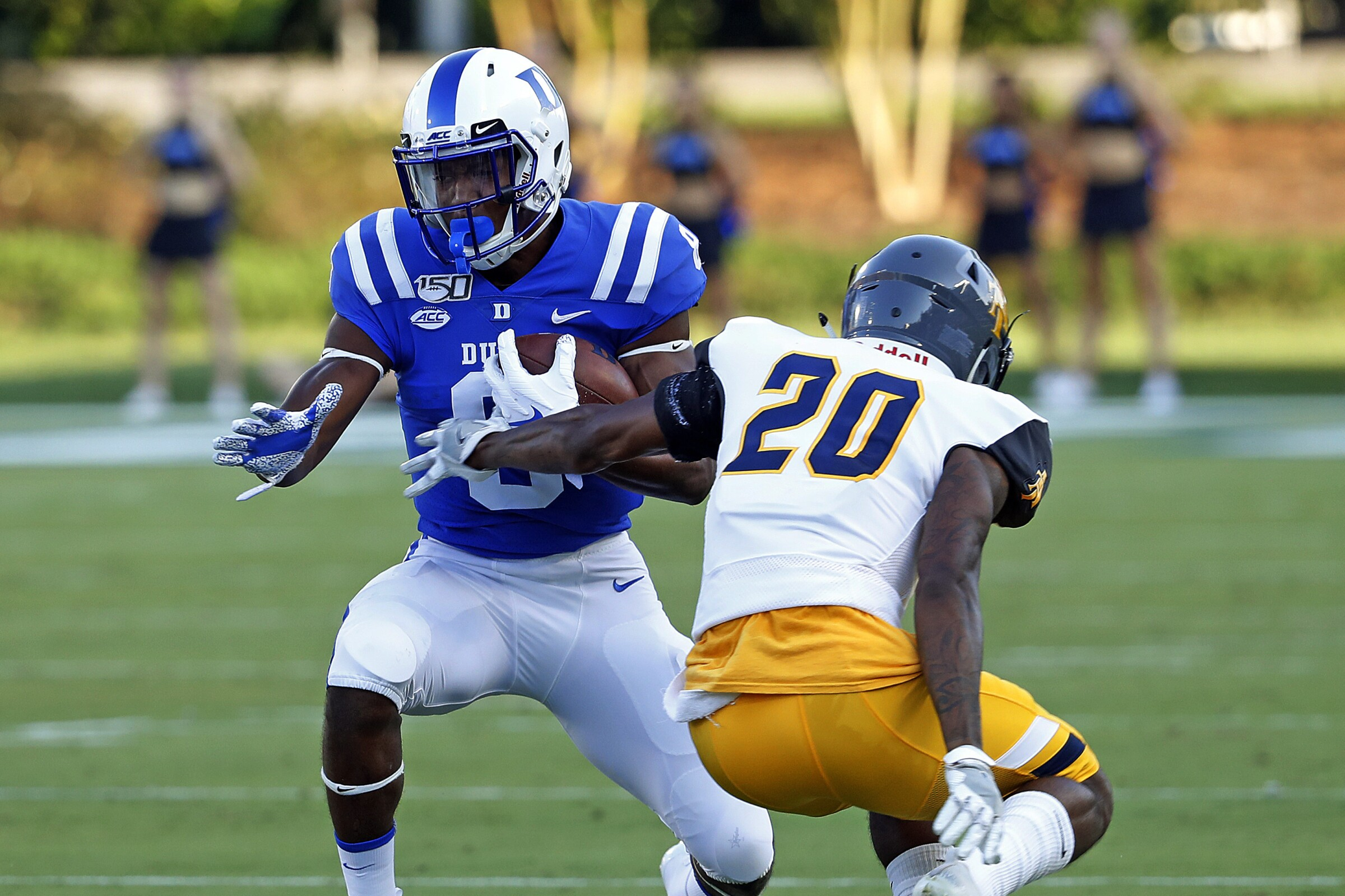 Duke's Brittain Brown (8) pulls away from North Carolina A&T's Najee Reams (20) .