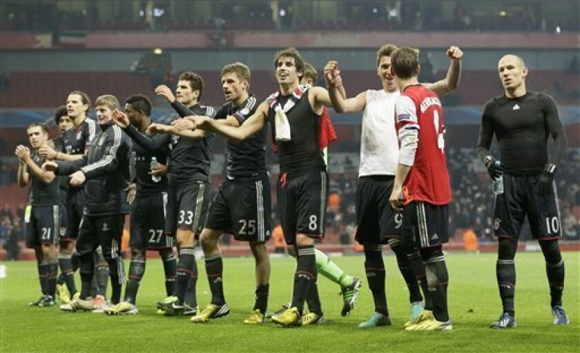 Bayern players celebrate 3-1 after winning the Champions League, round of 16, first leg soccer match between Arsenal and Bayern Munich at Arsenal's Emirates stadium in London, Tuesday, Feb.  19, 2013.(AP Photo/Alastair Grant)