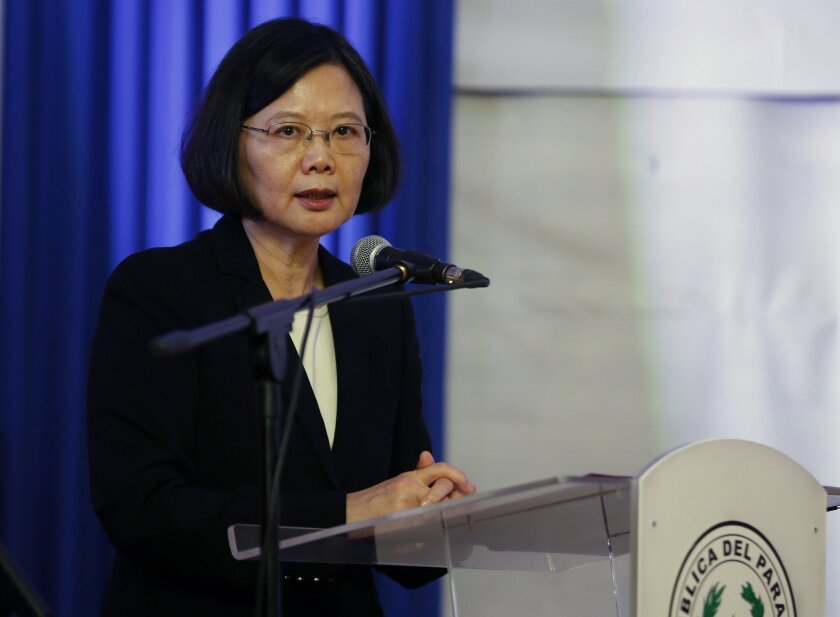 In this June 29, 2016 photo, Taiwan's President Tsai Ing-wen talks during a ceremony at the Gen. Andres Rodriguez school in Asuncion, Paraguay. Tsai on Monday, Aug. 1, 2016 apologized on behalf of the government to the island's aboriginal peoples for 400 years of conquest and colonization, saying t