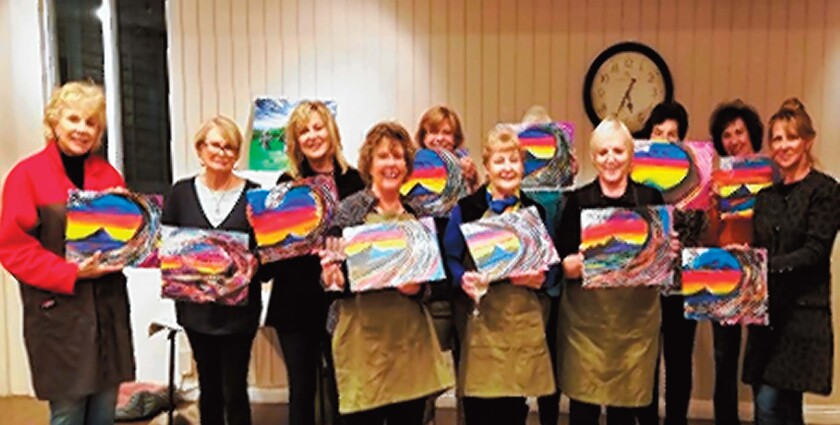 La Jolla Newcomers Club members show off their artwork after the 'Paint and Sip' party.