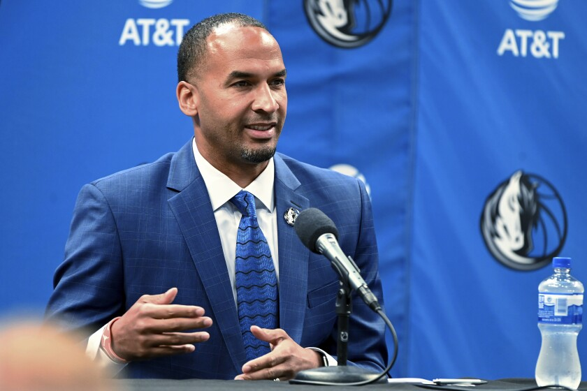 FILE - In this July 15, 2021, file photo, Nico Harrison speaks in Dallas after being introduced as the Dallas Mavericks' general manager. Harrison goes into his first NBA basketball draft without a pick because of the 2019 trade for Kristaps Porzingis. Harrison isn't ruling out the possibility of Dallas ending up with a selection through another trade. (AP Photo/Matt Strasen, File)