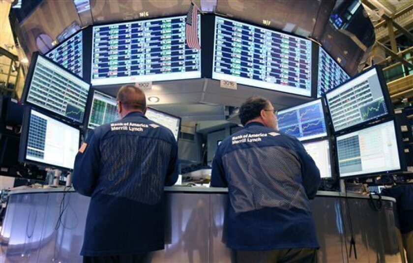 FILE - In this Tuesday, Aug. 23, 2011 file photo, Bank of America Merrill Lynch traders work on the floor of the New York Stock Exchange in New York. There are fewer and fewer traders on the NYSE floor because of the dominance of computer trading of securities - including the high-frequency trading that can take advantage of price changes in a millisecond. Bank of America is the stock of the moment for high-frequency trading; investors use computer algorithms to exploit small changes in a stock's price. If a computer can seize on a stock like Bank of America a fraction of a second faster than the rest of the market, it can book a tiny profit. (AP Photo/Henny Ray Abrams)
